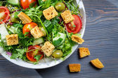 Closeup of healthy Caesar salad with croutons — Stock Photo