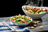 Salad from fresh vegetables and hot chicken — Stock Photo