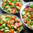 Three healthy salads with vegetables and chicken — Stock Photo