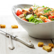 Close-up on a fresh salad with chicken on white background - Stock Photo