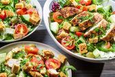 Closeup of three healthy salads with vegetables — Stock Photo