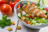 Close-up on a salad with chicken and tomato — Stock Photo