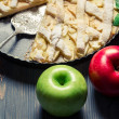 Two apples and freshly baked apple pie on old blue table — Stock Photo #16561363