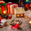 Cottages and gingerbread cookies on the Christmas table - Stock Photo