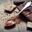 Cocoa Powder and bitter chocolate bar — Stock Photo #17094001