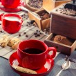 Brewed coffee served in a red cup — Stock Photo