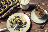 Poppy seed cake and cup of coffee on old table — Stock Photo