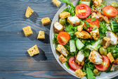 Healthy Caesar salad made of fresh vegetables and chicken — Stock Photo