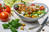 Closeup of healthy salad with chicken and ingredients — Stock Photo