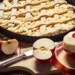 Closeup of freshly baked apple pie and apples — Stock Photo #18461017