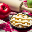 Small apple pie with fruits and a rolling pin — Stock Photo