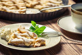 Closeup of piece of apple pie with cream on a plate — Stock Photo