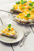 Closeup of peaches cake on old wooden table — Stock Photo
