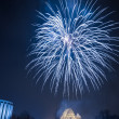Stock Photo: Spectacular fireworks over river at night