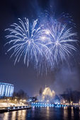 Small blue fireworks over the river — Stock Photo