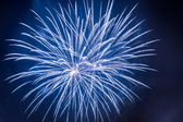 Blue fireworks during the celebrations event at night — Stock Photo