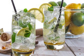 Closeup of fresh mojito with fruit — Stock Photo