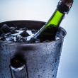Ice Bucket with cold champagne and ice — Stock Photo