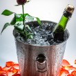 Red rose and cold champagne for Valentine's Day - Stock Photo
