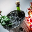 Red rose and cold champagne for celebration — Stock Photo