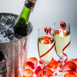 Cold champagne and red roses in the new year — Stock Photo