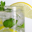 Closeup of lemon drink with ice cubes - Stock Photo