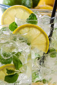 Closeup of cold lemon drink with mint — Stock Photo