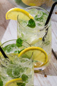 Cold lemon drink with mint leaf — Stock Photo