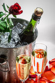 Closeu of red rose and cold champagne for Valentine's Day — Stock Photo