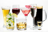 Different kinds of alcohol on a white background — Stock Photo