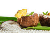 Pinacolada drink with fresh mint in coconut — Stock Photo