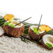 Few pinacolada drinks in coconut on white beach — Stock Photo