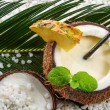 Pinacolada in a coconut on the beach — Stock Photo #20728829