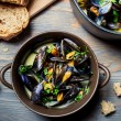 Closeup of mussels served with bread in a country way - Stock Photo
