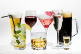 Various types of alcohol on a white background — Stock Photo