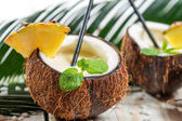 Pinacolada drink with mint served in a fresh coconut — Stock Photo