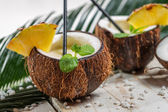 Fresh pinacolada drink served in a coconut — Stock Photo