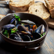 Closeup of Mussels served with bread - Stock Photo