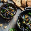 Fresh ingredients to prepare mussels - Stock Photo