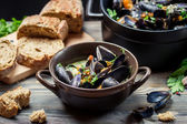 Closeup of mussels and fresh vegetables served at home — Stock Photo