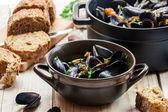 Closeup of mussels served in a sunny day — Stock Photo