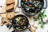 Mussels meal served with bread by the sea — Stock Photo