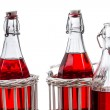 Three old bottles with red juice — Stock Photo
