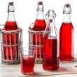 Stock Photo: Vintage bottles with red juice
