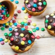 Easter muffins with chocolate glaze and candies — Stock Photo