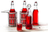 Vintage bottles with red juice — Stock Photo