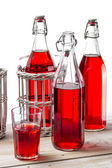 Closeup of vintage bottles with juice on white background — Stock Photo