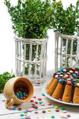 Traditional easter cake with candies and boxwood — Stock Photo