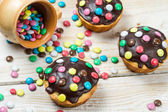 Easter muffins with chocolate glaze and candies — Photo
