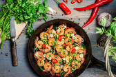 Hot shrimp fried in a pan with butter and herbs — Stock Photo